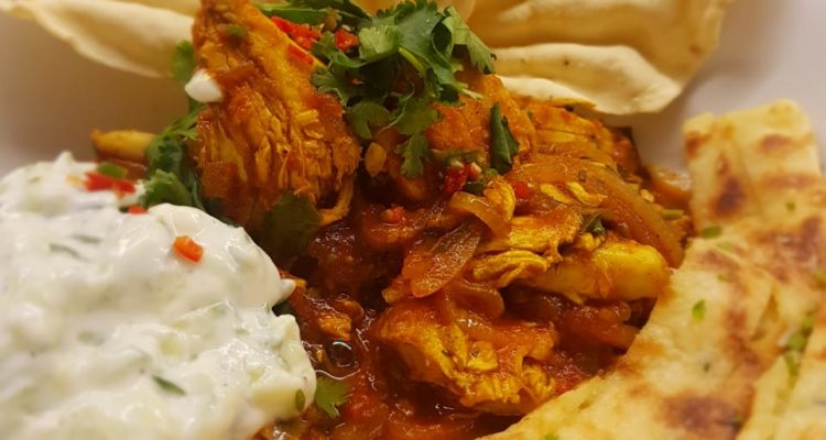Shredded Roast Chicken Curry with garlic naan and cucumber raita